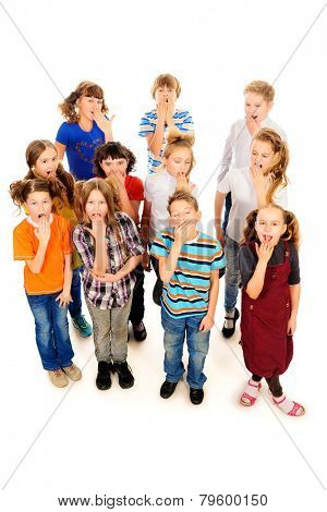 Group of children standing together and yawn. Isolated over white.