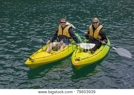 Happy Couple Kayaking on a lake together
