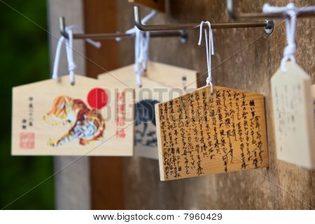 Wooden prayer boards hanging at a Japanese Shinto shrine.