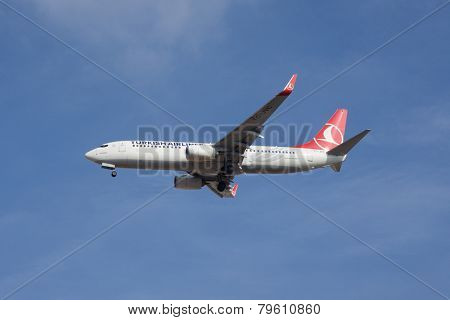 VALENCIA, SPAIN - JANUARY 6, 2015: A Turkish Airlines Boeing 737-800 landing at the Valencia Airport. Turkish Airlines is the national flag carrier airline of Turkey.