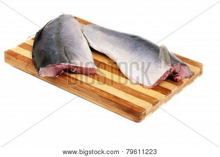 Ctting Board With Tuna Steak Slices On A White Background.