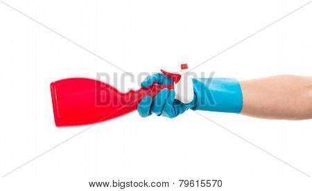 Hand holding red plastic spray bottle.