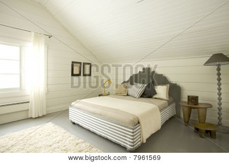 wide bedroom in the attic