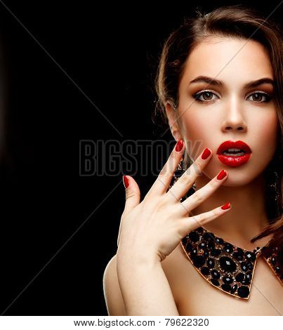 Beauty Model Woman With Long Brown Wavy Hair. Healthy Hair And Beautiful Professional Makeup. Red Li