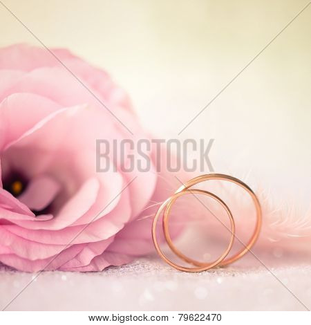 Love Wedding Background with Gold Rings and Beautiful Flower - macro