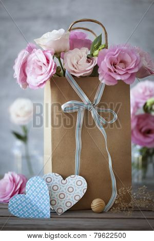 St. Valentines Day background with pink flowers, blue bow and hearts