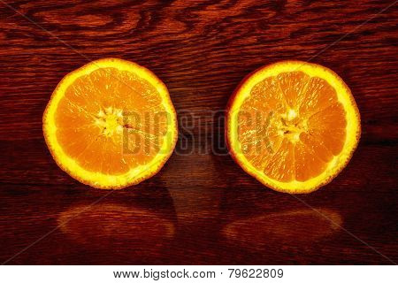 orange cut in half on wooden table