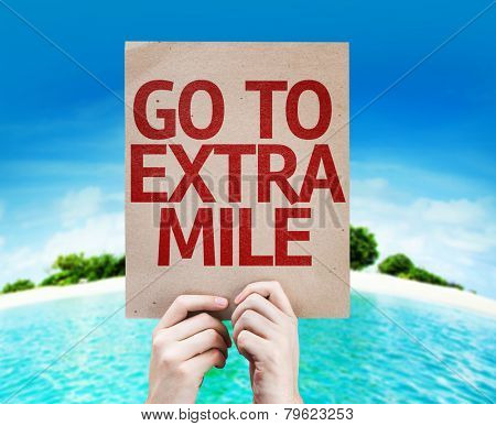 Go To Extra Mile card with a beach on background