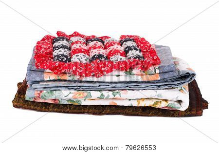 Stack of bedding set with flowers.