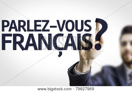 Business man pointing to transparent board with text: Do You Speak French? (In French)