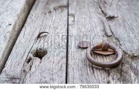 Old doorknocker and door, perspective view, shallow depth of field