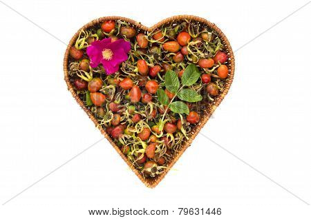 Fresh Summer Rose Hips In Heart Form Wicker Basket Isolated