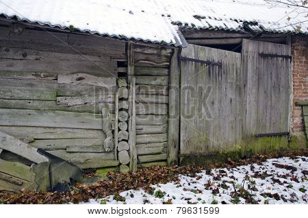 Ancient Farm Barn Wall With Wooden Door