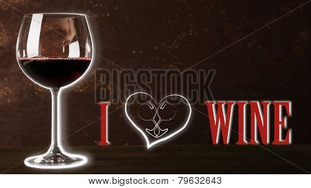 Wineglass with red wine and I love wine text, on dark brown background