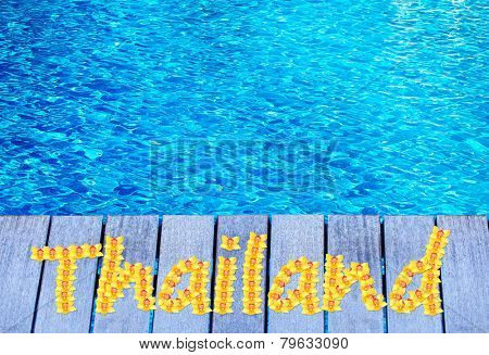 Thailand vacation holidays background. Wooden bridge on way to harbor, close-up