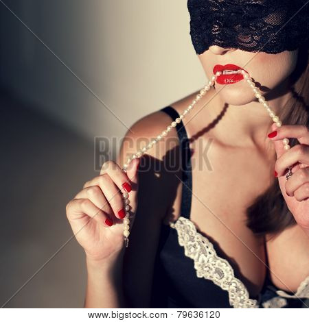 Sexy Woman With Red Lips Bite Pearls In Vintage Style