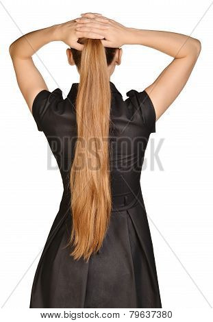 beautiful woman standing with back and put her hands on head.