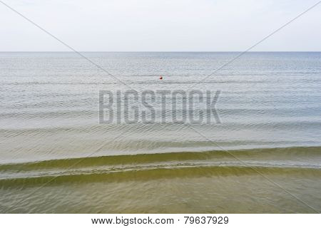 Red Buoy Floating On The Sea Calm