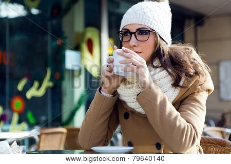 Portrait Of Young Beautiful Woman Drinking Coffee Outdoor.