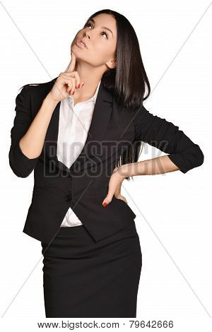 Business woman looking up forefinger pressed on the chin.