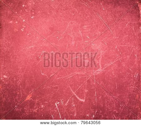 Red Grunge Abstract Textured background with spotlight and scratches.