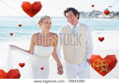 Newlyweds walking hand in hand and laughing against happy valentines day
