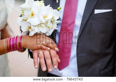 Hands Of Man And Woman With Rings And Traditional Indian Jewelry
