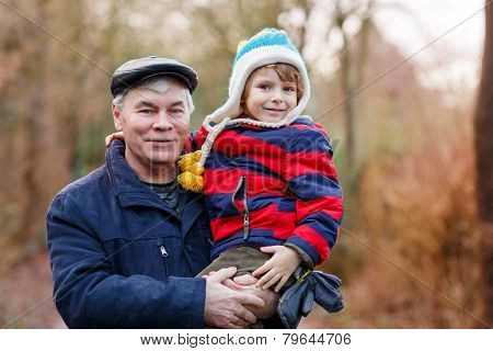 Happy Grandfather With His Grandchild On Arm