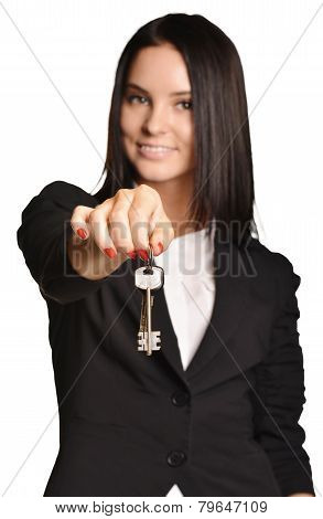 Beautiful girl broker holding sale house key.
