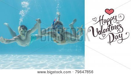 Cute couple underwater in the swimming pool with snorkel and starfish against happy valentines day