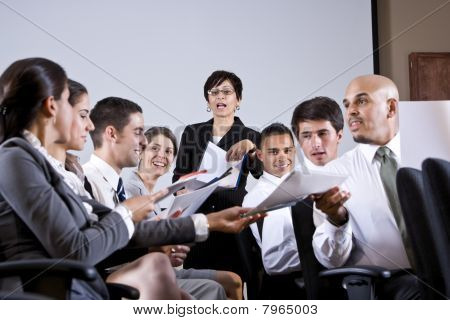 Group Business Presentation Handing Out Papers