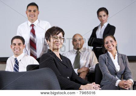 Mature Hispanic Businesswoman Leading Office Group