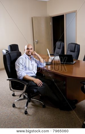 Mid-adult Hispanic Office Worker In Boardroom