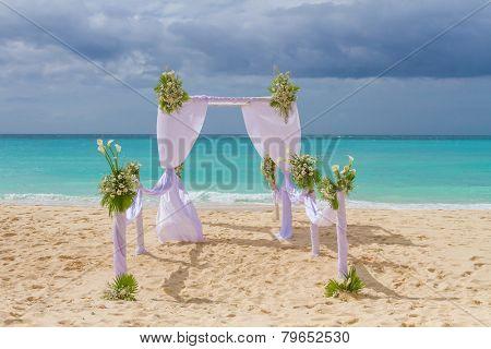 beautiful wedding arch, cabana on sand beach, outdoor beach wedding