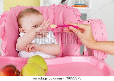Playful Baby Girl Eating