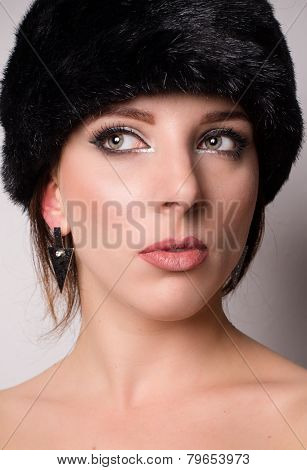 Attractive Pensive Young Woman In A Winter Hat