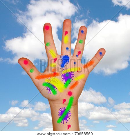 Painted hand with a blue sky and clouds of background