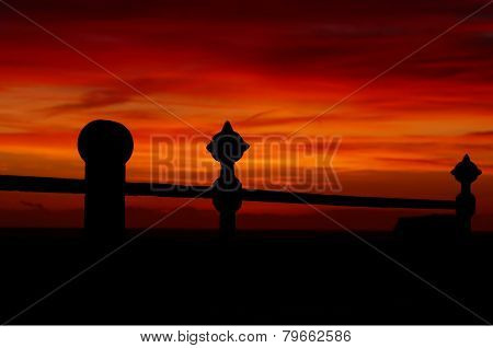 Sunset with seaside railings silhouette