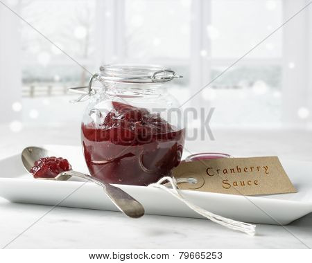 Cranberry sauce in glass jar with label