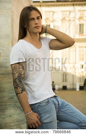 Handsome Long Hair Man on White Shirt Standing in Turin, Italy