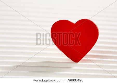 Red heart on white wrinkled background