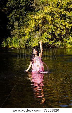 Japanese American Woman In River Splashing Water