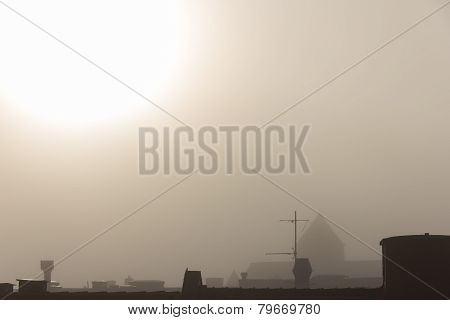 Fog over roof tops