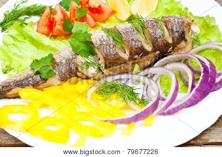 fish hake baked with vegetables