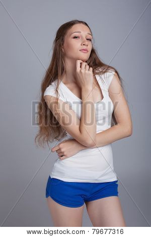 Image of pretty girl with sly look on her face