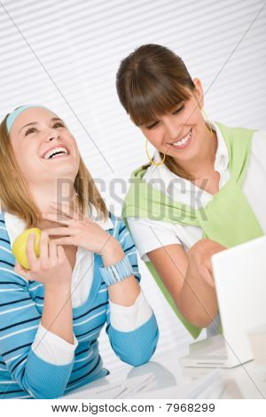 Student At Home - Two Happy Young Woman With Laptop