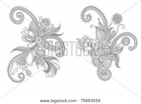 Two intricate swirling floral elements