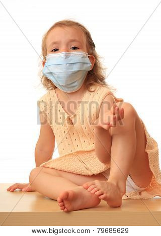 Girl is in a medical mask.