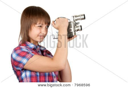 Girl In Plaid Shirt With Movie Camera