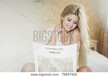 Young woman posing while sitting on a chair